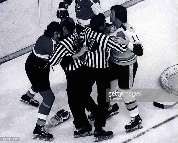 Dave Schultz of the Philadelphia Flyers tries to fight Carol Vadnais of the Boston Bruins during their game circa 1972 at the Boston Garden in Boston...
