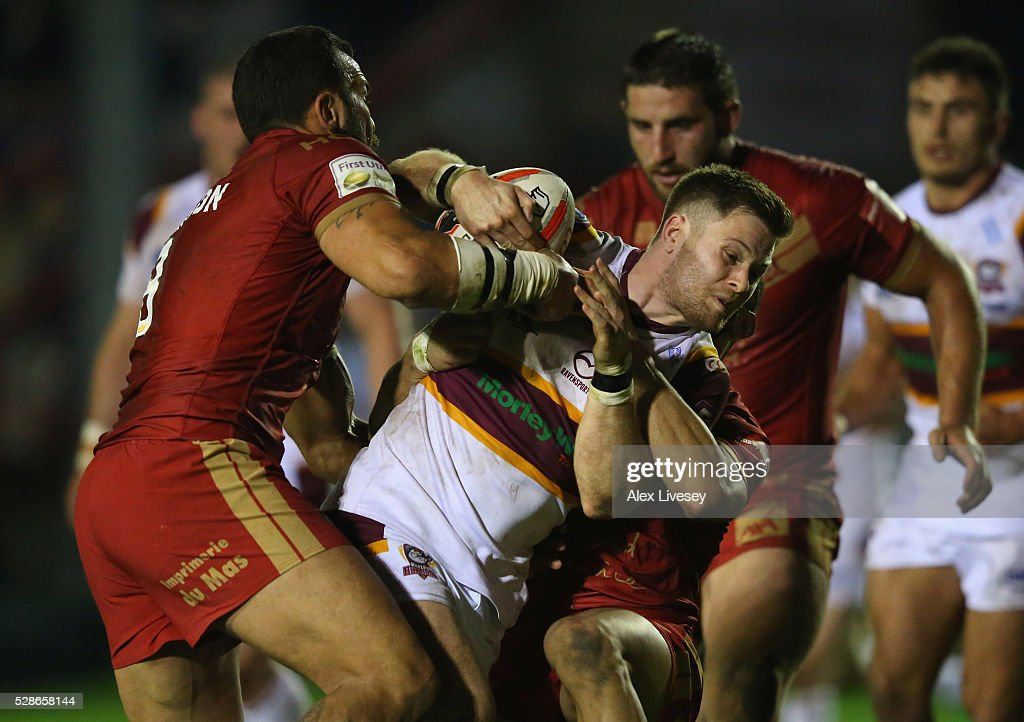 Dave Scott of Batley Bulldogs is tackled by Louis Anderson of Catalan Dragons during the Ladbrokes Challenge Cup Sixth Round match between Batley Bulldogs and Catalan Dragons at the Fox's Biscuits Stadium on May 06, 2016 in Batley, England.