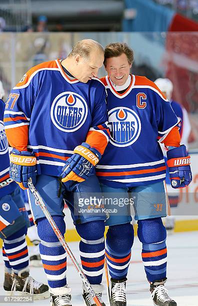 Dave Semenko and Wayne Gretzky of the Edmonton Oilers alumni share a laugh during the pregame warm up prior to puck drop against the Winnipeg Jets...