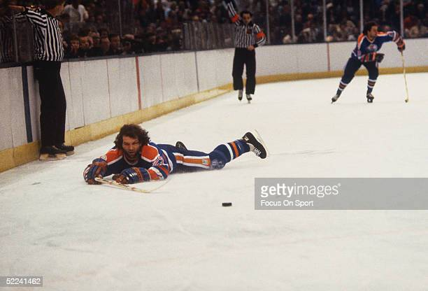 Dave Semenko of the Edmonton Oilers falls to the ice during an 1984 Stanley Cup Finals game against the New York Islanders in May 1984 at the Nassau...