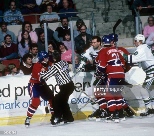 Dave Semenko of the Hartford Whalers tries to get at Chris Nilan of the Montreal Canadiens as Nilan's teammate Guy Carbounneau tries to hold Semenko...