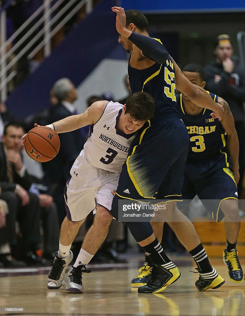 Dave Sobolewski #3 of the Northwestern Wildcats collides with Jordan Morgan #52 of the Michigan Wolverines at Welsh-Ryan Arena on January 3, 2013 in Evanston, Illinois. Michigan defeated Northwestern 94-66.