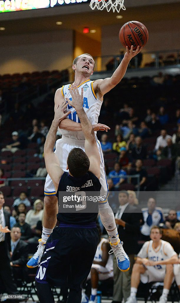 Dave Sobolewski #3 of the Northwestern Wildcats is called for a blocking foul as Bryce Alford #20 of the UCLA Bruins drives to the basket during the Continental Tire Las Vegas Invitational at the Orleans Arena on November 29, 2013 in Las Vegas, Nevada. UCLA won 95-79.