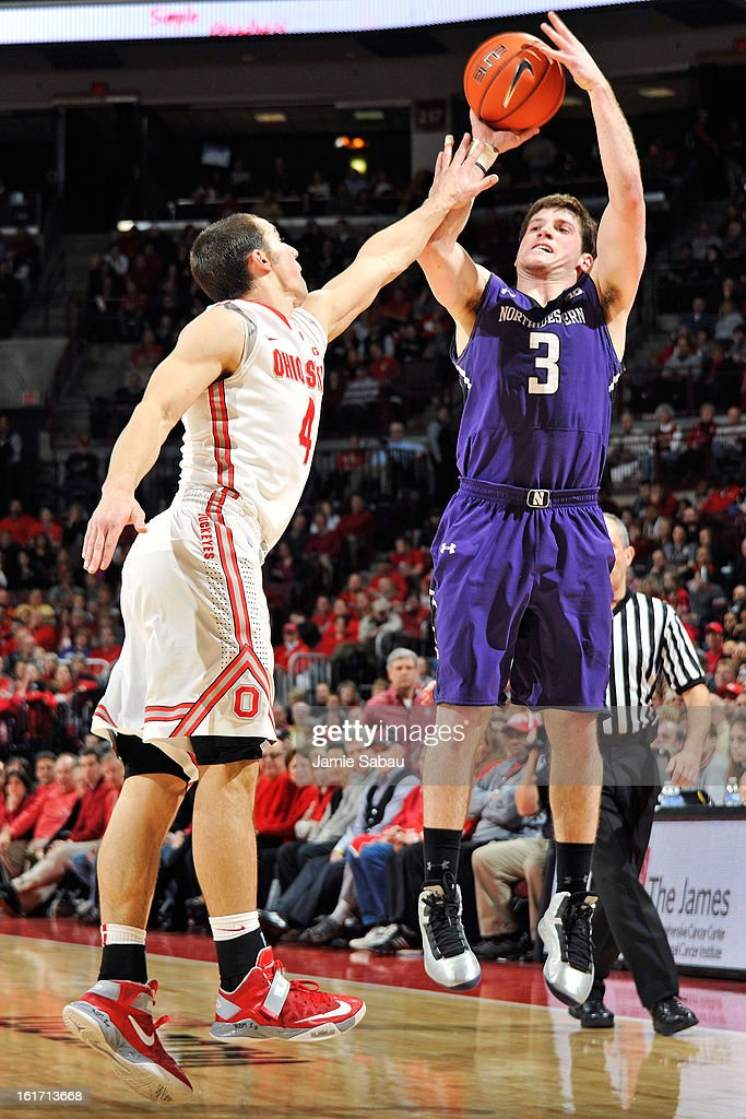 Dave Sobolweski #3 of the Northwestern Wildcats shoots over <a gi-track='captionPersonalityLinkClicked' href=/galleries/search?phrase=Aaron+Craft&family=editorial&specificpeople=7348782 ng-click='$event.stopPropagation()'>Aaron Craft</a> #4 of the Ohio State Buckeyes in the first half on February 14, 2013 at Value City Arena in Columbus, Ohio.