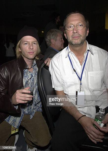 Dave Spade and Eric Clapton during The Concert for New York City Backstage at Madison Square Garden in New York City New York United States