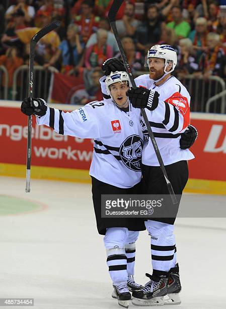 Dave Spina and Henrik Tallibder of TPS Turku during the Champions Hockey League group stage game between Dusseldorfer EG and TPS Turku on August 29...