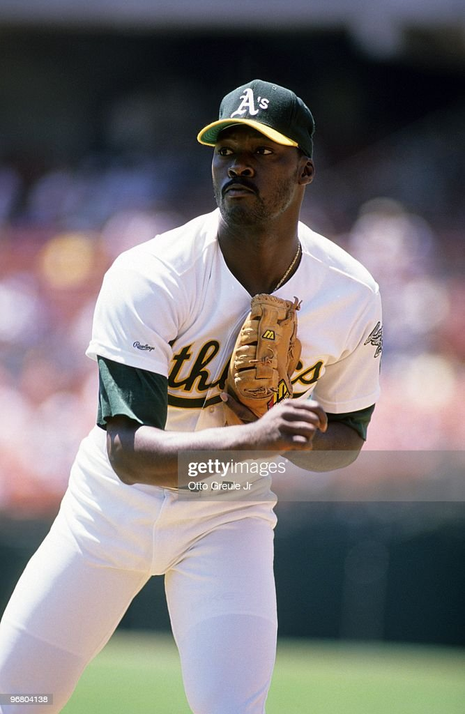 Dave Stewart of the Oakland Athletics pitches during an MLB game circa 1988 at OaklandAlameda County Coliseum in Oakland California