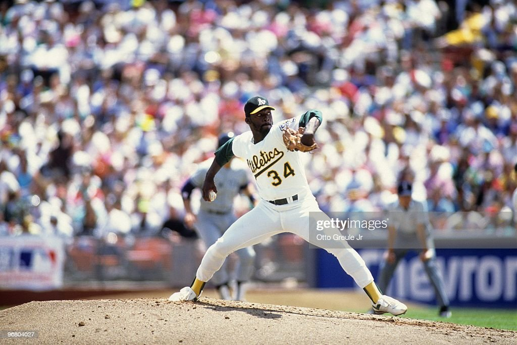 Dave Stewart of the Oakland Athletics pitches during an MLB game against the New York Yankees circa 1990 at OaklandAlameda County Coliseum in Oakland...