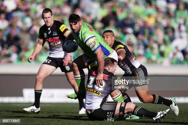 Dave Taylor of the Raiders takes on the defence during the round 24 NRL match between the Canberra Raiders and the Penrith Panthers at GIO Stadium on...