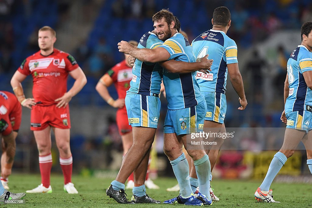 Dave Taylor of the Titans celebrates victory with team mates during the round 25 NRL match between the Gold Coast Titans and the St George Illawarra Dragons at Cbus Super Stadium on August 30, 2015 on the Gold Coast, Australia.