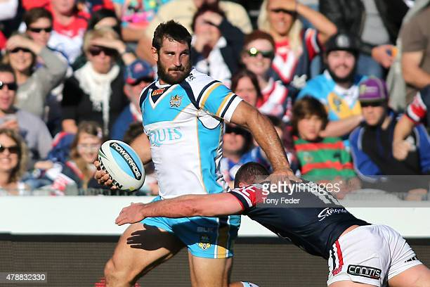 Dave Taylor of the Titans is tackled during the round 16 NRL match between the Sydney Roosters and the Gold Coast Titans at Central Coast Stadium on...