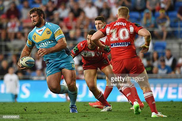 Dave Taylor of the Titans makes a break during the round 25 NRL match between the Gold Coast Titans and the St George Illawarra Dragons at Cbus Super...