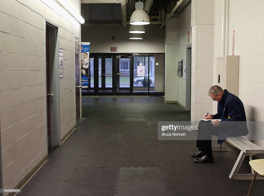 Dave Taylor, Vice President of Hockey Operations for the St. Louis Blues checks out the rosters prior to the USA Blue vs.USA White game during the 2014 USA Hockey Junior Evaluation Camp at Lake Placid Olympic Center on August 2, 2014 in Lake Placid, New York.