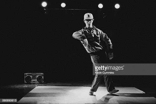 Dave 'The Wave' of the Broken Glass Crew breakdancing group performing on stage at The Hacienda nightclub Manchester 3rd October 1983