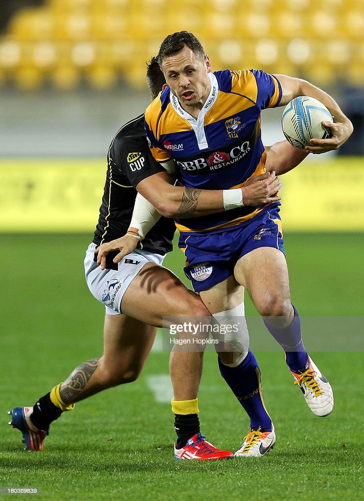 Dave Thomas of Bay of Plenty is tackled during the round 5 ITM Cup match between Wellington and the Bay of Plenty at Westpac Stadium on September 12, 2013 in Wellington, New Zealand.