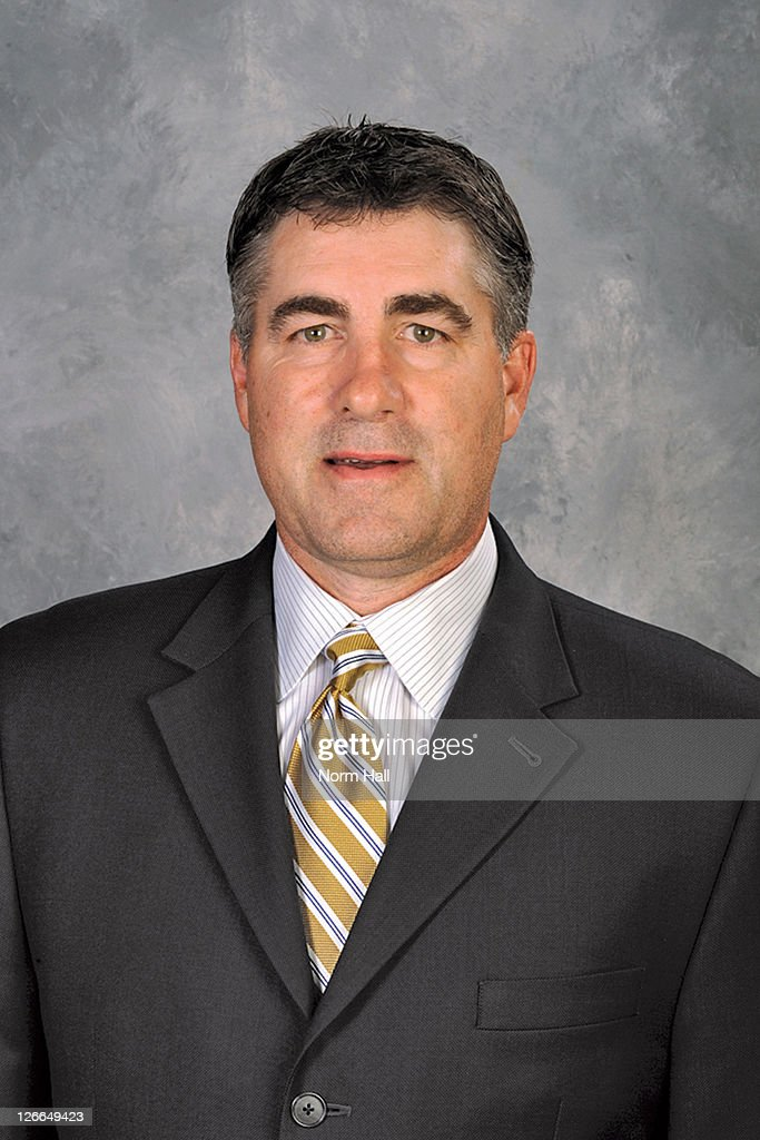 Dave Tippett of the Phoenix Coyotes poses for his official headshot for the 20102011 NHL season