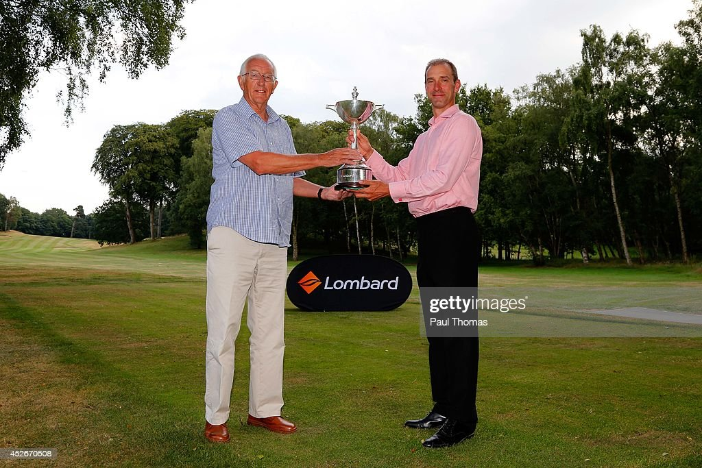 Dave Tweddle (L) and Adrian Hill of Pryors Hayes Golf Club pose with the trophy during The Lombard Trophy North West Regional Qualifier at Dunham Forest Golf Club on July 25, 2014 in Altrincham, England.