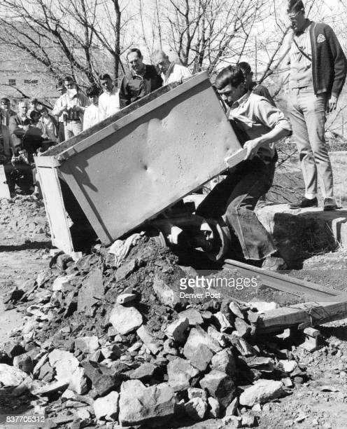 Dave Wahl Dumps Carload of Newly Blasted Rock Next he had to reload the heavy rocks with hand shovel Credit Denver Post