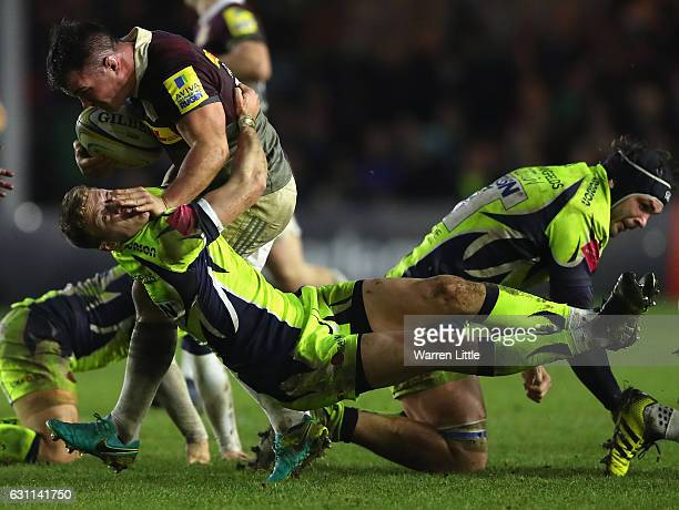 Dave Ward of Harlequins hands off Mike Haley of Sale Sharks during the Aviva Premiership match between Harlequins and Sale Sharks at Twickenham Stoop...