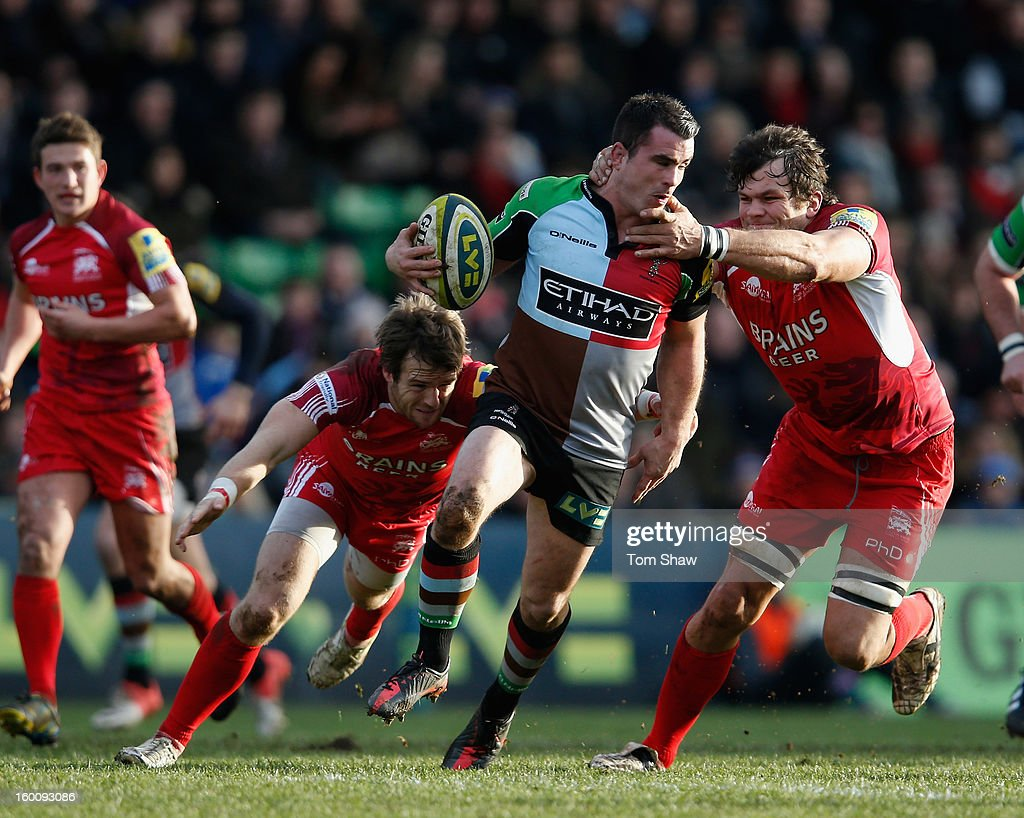 Dave Ward of Quins is tackled during the LV= Cup match between Harlequins and London Welsh at Twickenham Stoop on January 26, 2013 in London, England.