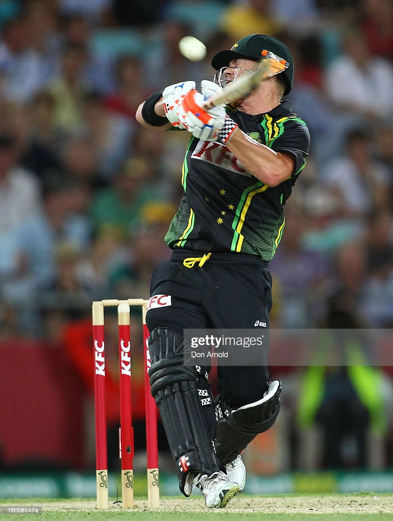 Dave Warner hooks Angelo Mathews for six during game one of the Twenty20 international match between Australia and Sri Lanka at ANZ Stadium on January 26, 2013 in Sydney, Australia.