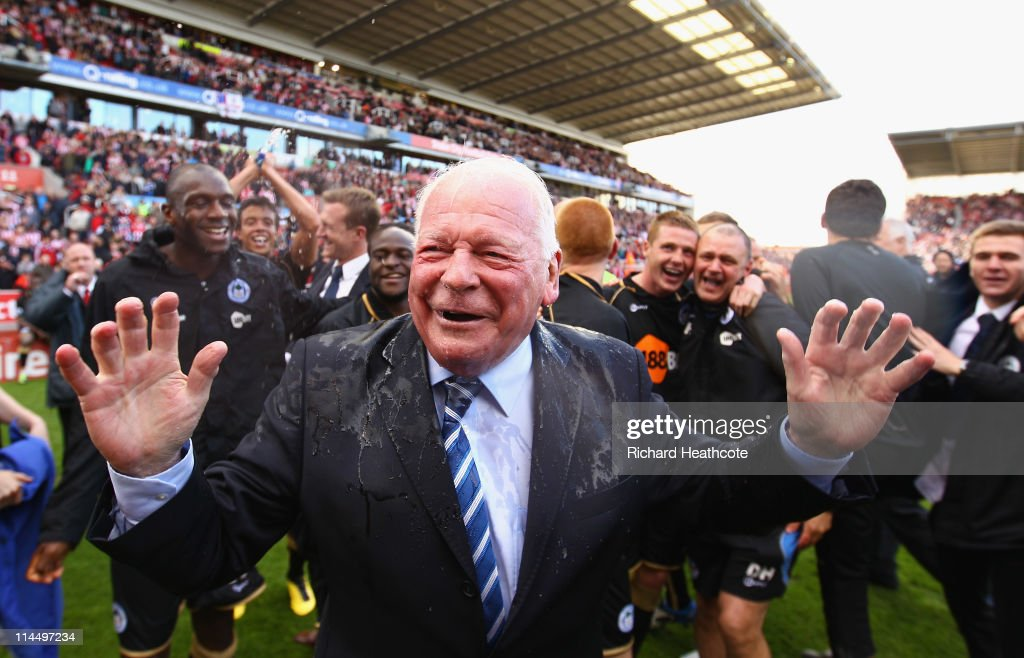 Dave Whelan, Chairman of Wigan Athletic is soaked with champagne after winning 1-0 to keep them in the Premiere League during the Barclays Premier League match between Stoke City and Wigan Athletic at Britannia Stadium on May 22, 2011 in Stoke on Trent, England.