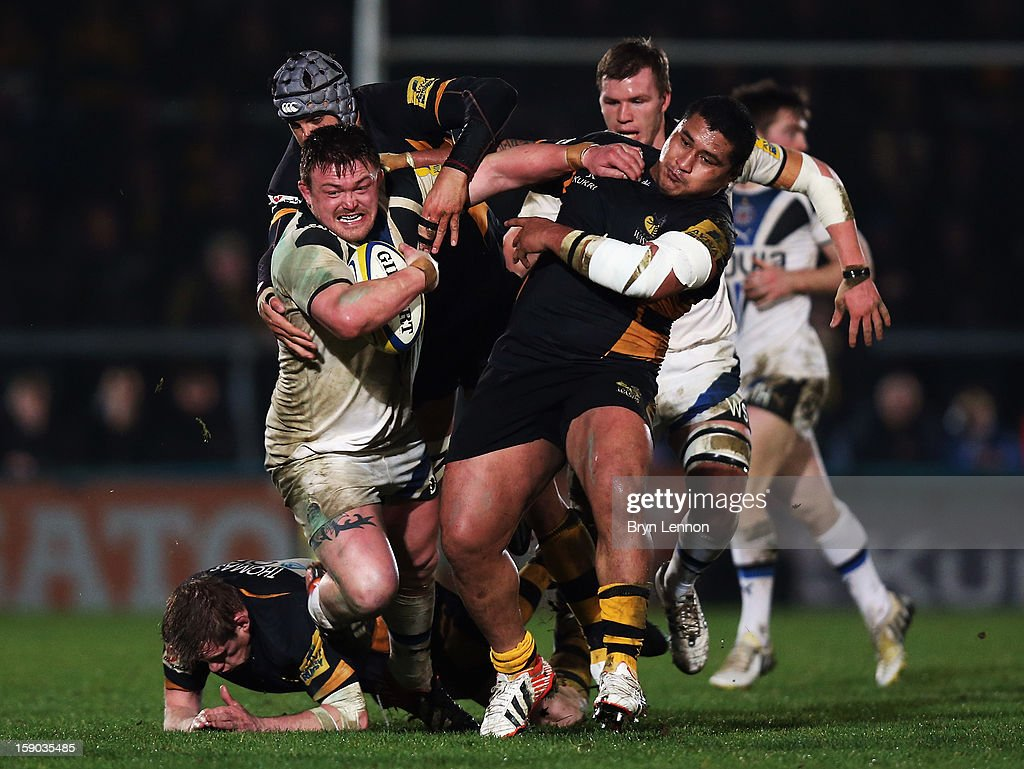 Dave Wilson of Bath Rugby is tackled by Zak Taulafo of London Wasps during the Aviva Premiership match between London Wasps and Bath at Adams Park on January 6, 2013 in High Wycombe, England.