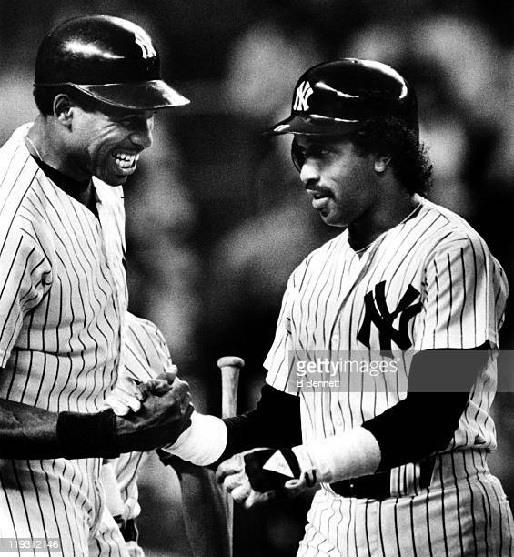 Dave Winfield of the New York Yankees congratulates teammate Oscar Gamble after Gamble hit his eigth home run of the season during the second inning...