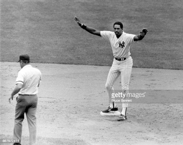 Dave Winfield of the New York Yankees gives the safe sign as he stands on second base during an MLB game circa 1980's at Yankee Stadium in the Bronx...