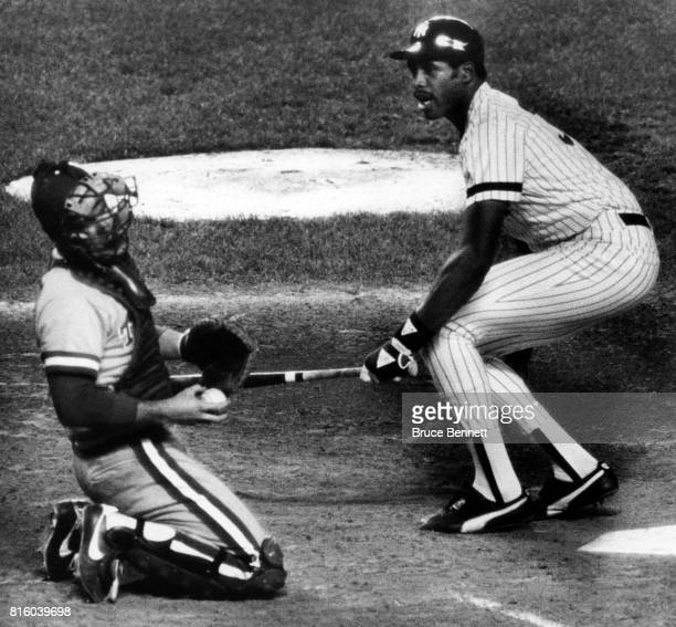 Dave Winfield of the New York Yankees hits catcher Jim Sundberg of the Texas Rangers after Winfield swung and missed a pitch during an MLB game on...