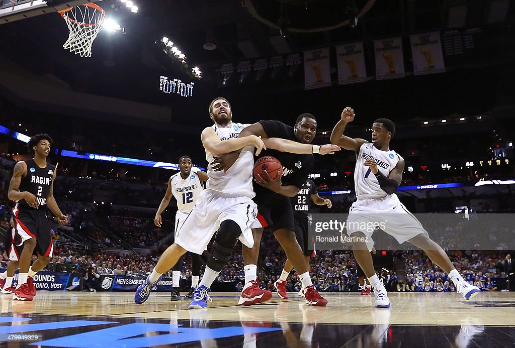 J Davenport of the Louisiana Lafayette Ragin Cajuns fights for the ball with Ethan Wragge of the Creighton Bluejays in the second half during the...