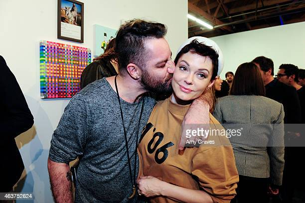 Davey Detail and Rose McGowan attend the 8th Annual Pieces of Heaven Art Auction Presented by Samsung Galaxy at MAMA Gallery on February 17 2015 in...