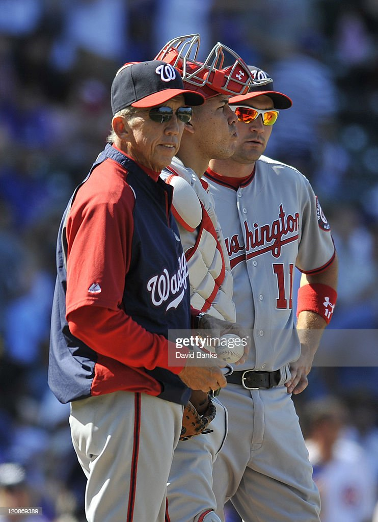 Davey Johnson manager of the Washington Nationals makes a pitching change on August 11 2011 at Wrigley Field in Chicago Illinois The Cubs defeated...