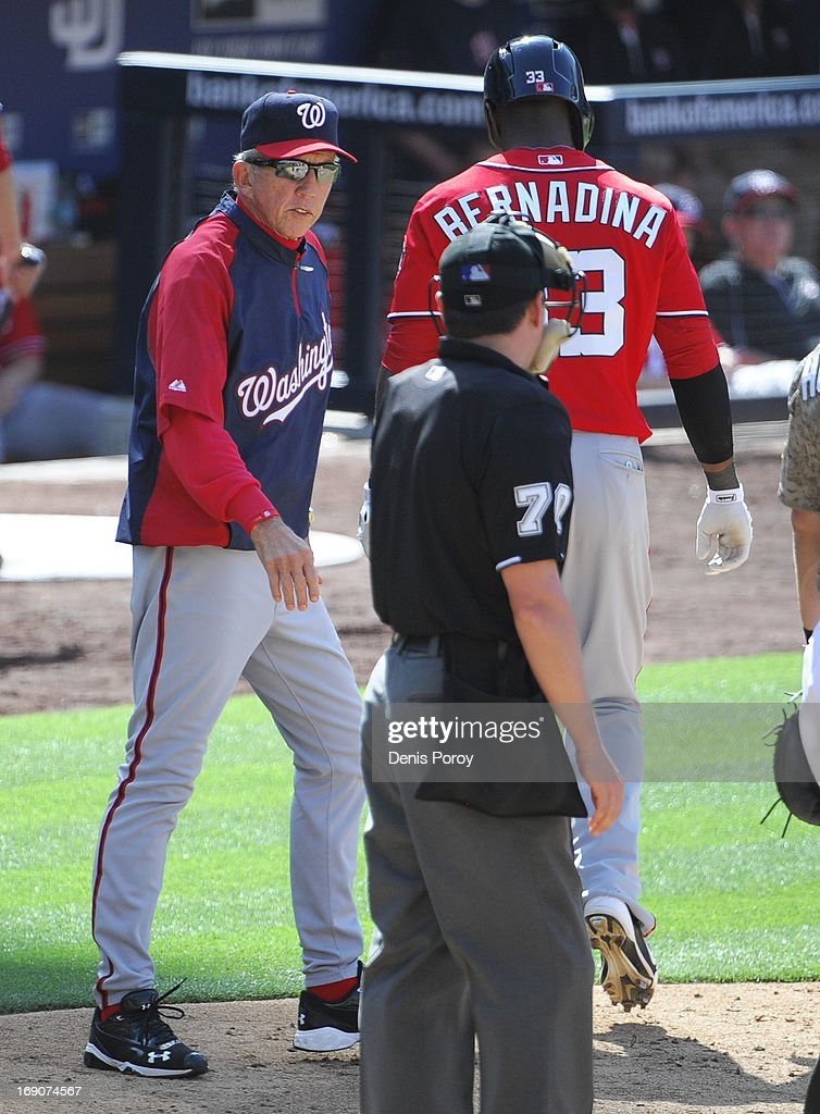 Davey Johnson #5 of the Washington Nationals, left, yells at umpire D.J. Reyburn after Roger Bernadina #33 struck out during the eigthh inning of a baseball game against the San Diego Padres at Petco Park on May 19, 2013 in San Diego, California.