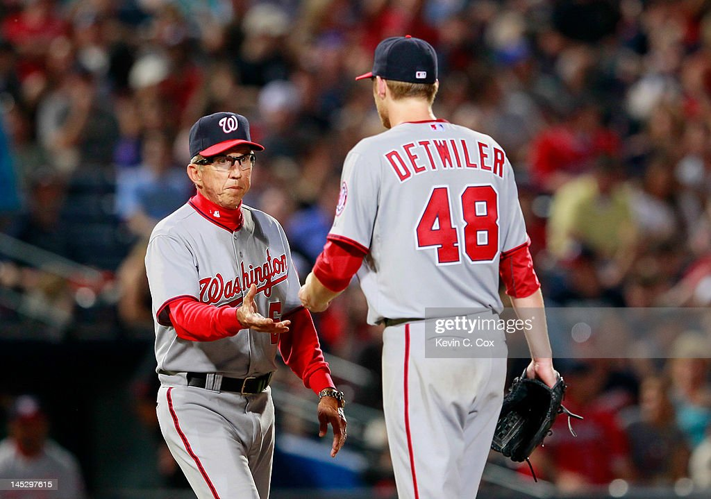 <a gi-track='captionPersonalityLinkClicked' href=/galleries/search?phrase=Davey+Johnson+-+Baseball+Manager&family=editorial&specificpeople=93273 ng-click='$event.stopPropagation()'>Davey Johnson</a> #5 of the Washington Nationals pulls <a gi-track='captionPersonalityLinkClicked' href=/galleries/search?phrase=Ross+Detwiler&family=editorial&specificpeople=4329174 ng-click='$event.stopPropagation()'>Ross Detwiler</a> #48 in the fifth inning against the Atlanta Braves at Turner Field on May 25, 2012 in Atlanta, Georgia.