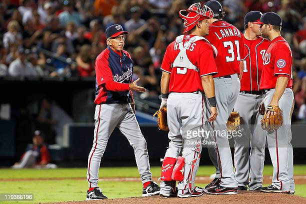 Davey Johnson of the Washington Nationals walks out to the pitcher's mound to relieve a John Lannan in the game against the Atlanta Braves on July 16...
