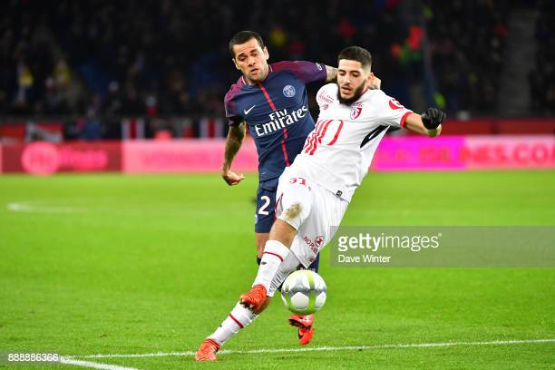 Davi Alves of PSG and Yassine Benzia of Lille during the Ligue 1 match between Paris Saint Germain and Lille OSC at Parc des Princes on December 9...