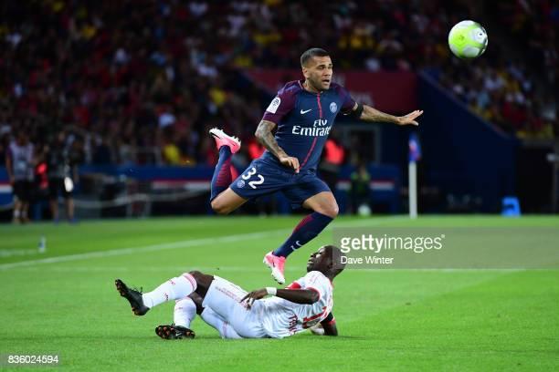 Davi Alves of PSG hurdles Max Alain Gradel of Toulouse during the Ligue 1 match between Paris Saint Germain and Toulouse at Parc des Princes on...