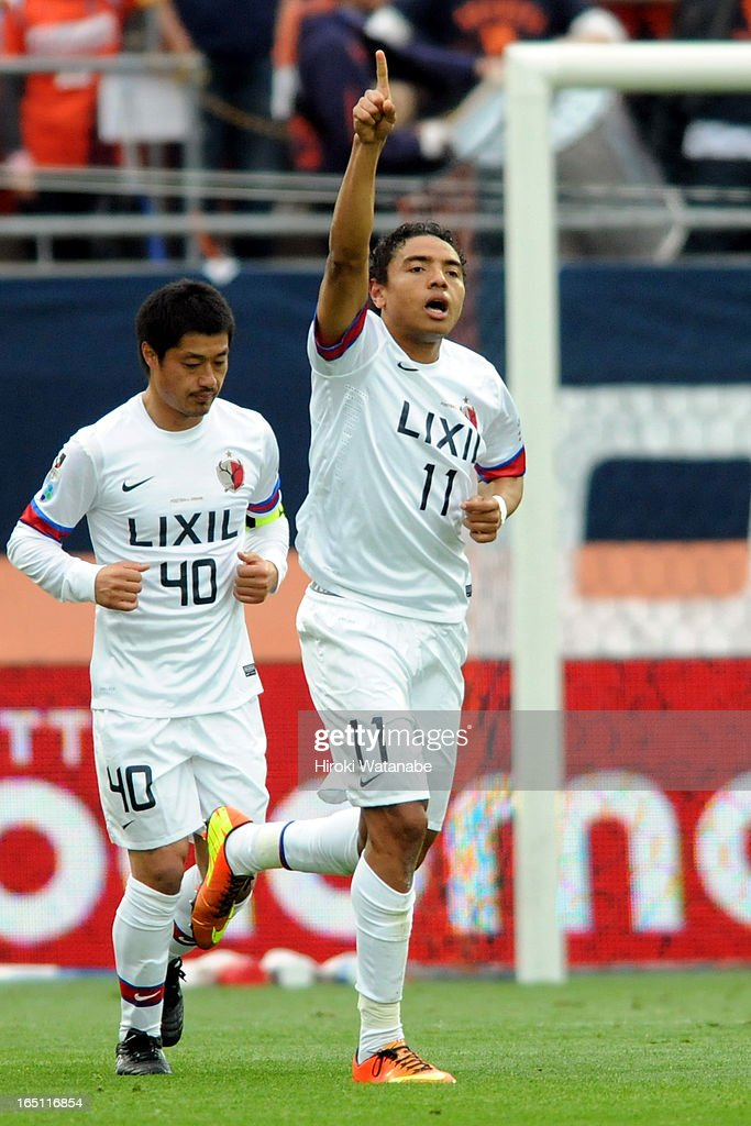 Davi Jose Silva do Nascimento of Kashima Antlers celebrates scoring the first goal during the J.League match between Omiya Ardija and Kashiwa Reysol at Nack 5 Stadium Omiya on March 30, 2013 in Saitama, Japan.