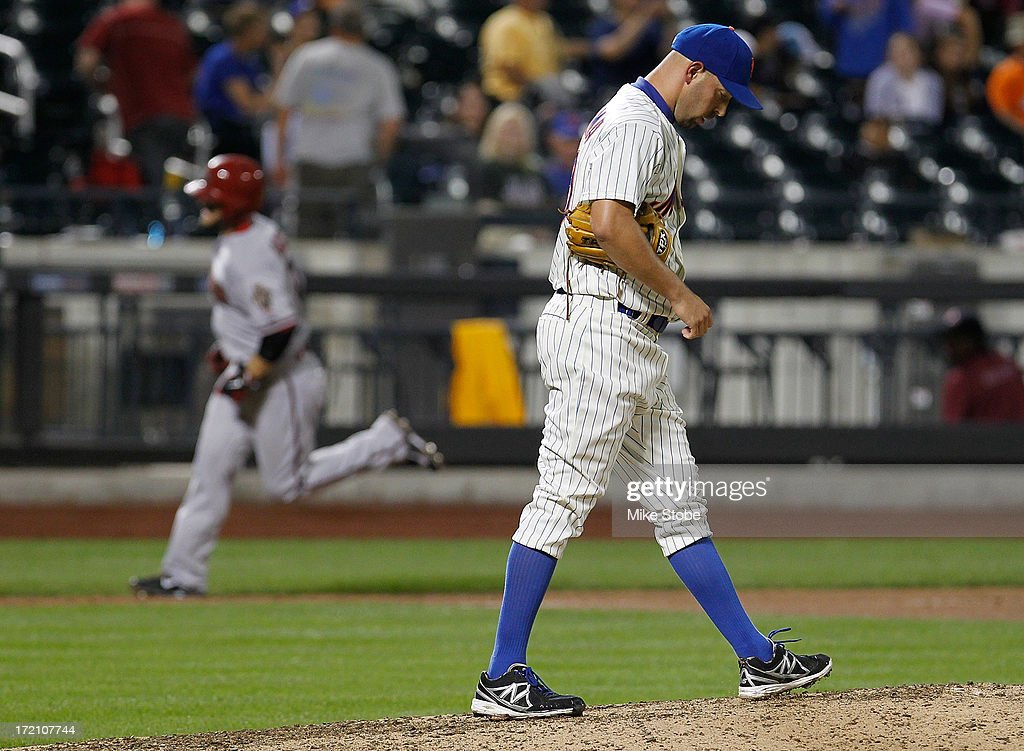 <a gi-track='captionPersonalityLinkClicked' href=/galleries/search?phrase=David+Aardsma&family=editorial&specificpeople=233636 ng-click='$event.stopPropagation()'>David Aardsma</a> #30 of the New York Mets looks on as <a gi-track='captionPersonalityLinkClicked' href=/galleries/search?phrase=Cody+Ross&family=editorial&specificpeople=545810 ng-click='$event.stopPropagation()'>Cody Ross</a> #7 of the Arizona Diamondbacks rounds the bases after hitting a solo home run in the thirteenth inning against the New York Mets at Citi Field on July 1, 2013 at Citi Field in the Flushing neighborhood of the Queens borough of New York City.