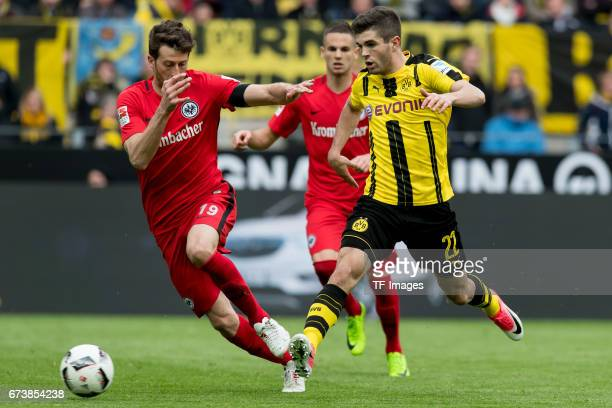 David Abraham of Frankfurt and Christian Pulisic of Dortmund battle for the ball during the Bundesliga match between Borussia Dortmund and Eintracht...