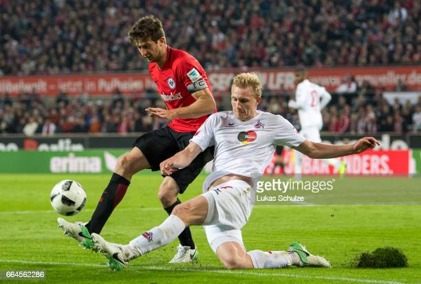 David Abraham of Frankfurt and Frederik Soerensen of Koeln in action during the Bundesliga match between 1 FC Koeln and Eintracht Frankfurt at...