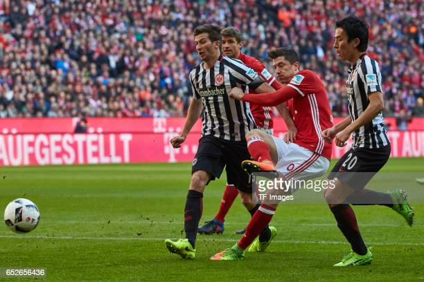 David Abraham of Frankfurt and Makoto Hasebe of Frankfurt and Robert Lewandowski of Muenchen battle for the ball during the Bundesliga match between...
