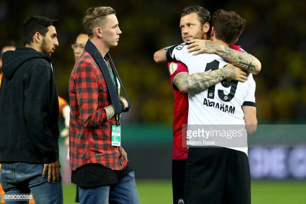 David Abraham of Frankfurt and Marco Russ of Frankfurt look dejected after losing the DFB Cup Final 2017 between Eintracht Frankfurt and Borussia...