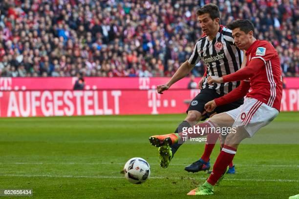 David Abraham of Frankfurt and Robert Lewandowski of Muenchen battle for the ball during the Bundesliga match between Bayern Muenchen and Eintracht...