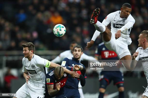 David Abraham of Frankfurt Arturo Vidal of Bayern Muenchen Javi Martinez of Bayern Muenchen dug while Sebastien Haller of Frankfurt jumps to reach...