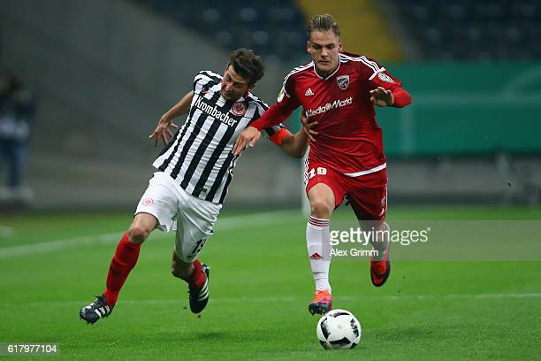 David Abraham of Frankfurt is challenged by Max Christiansen of Ingolstadt during the DFB Cup Second Round match between Eintracht Frankfurt and FC...