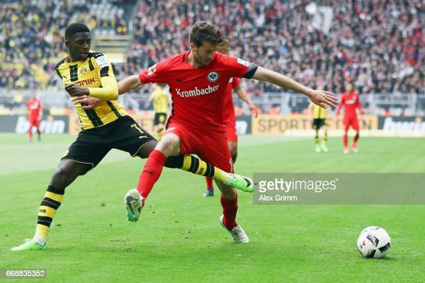 David Abraham of Frankfurt is challenged by Ousmane Dembele of Dortmund during the Bundesliga match between Borussia Dortmund and Eintracht Frankfurt...