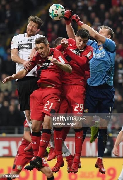 David Abraham of Frankfurt jumps for a header with Dominik Kohr Kai Havertz and Goalkeeper Bernd Leno of Leverkusen during the Bundesliga match...