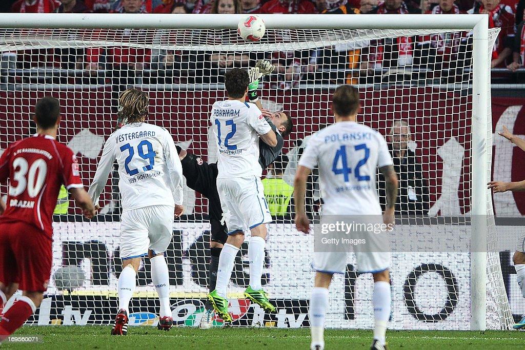 David Abraham of Hoffenheim scores his team's first goal past goalkeeper Tobias Sippel of Kaiserslautern during the Bundesliga Playoff Second Leg...